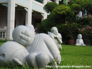 Statues of little novices sleeping peacefully. Taken in Kong Meng Shan, Singapore.